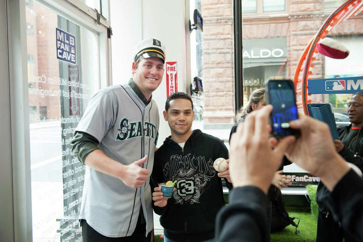 Brandon Maurer of the Seattle Mariners poses with a fan while filming a sketch.