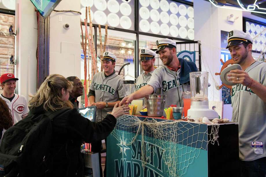 Tom Wilhelmsen greets fans and serves lemonade drinks with teammates Lucas Luetge, Charlie Furbush, and Brandon Maurer of the Seattle Mariners while filming a sketch. Photo: Thomas Levinson, MLB Photos Via Getty Images / 2013 Major League Baseball Photos