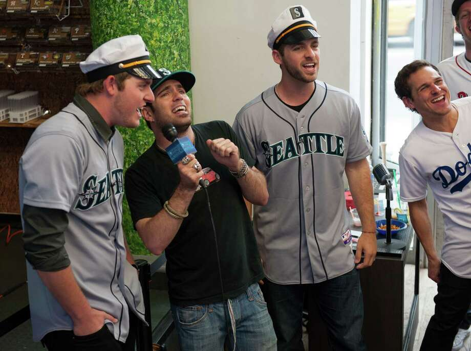Brandon Maurer and Lucas Luetge of the Seattle Mariners sing karaoke with a fan. Photo: Thomas Levinson, MLB Photos Via Getty Images / 2013 Major League Baseball Photos