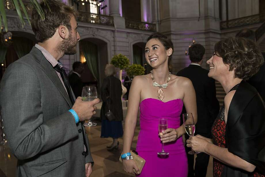Dylan Laycox, Rebecca Miller and Kim Miller (left to right) chat during the cocktail hour at the San Francisco Symphony's inaugural Spring Gala at City Hall in San Francisco, Calif., on Thursday, May 16, 2013.  The event raised money for the symphony's education programs. Photo: Laura Morton, Special To The Chronicle