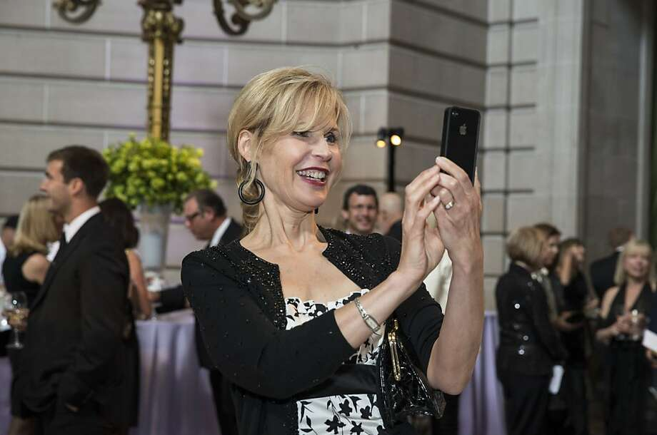 Julie Ambrose snaps a photo for a friend while attending the San Francisco Symphony's inaugural Spring Gala at City Hall in San Francisco, Calif., on Thursday, May 16, 2013.   The gala raised money for the symphony's education programs. Photo: Laura Morton, Special To The Chronicle