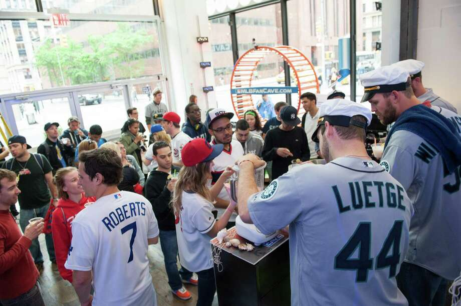 Charlie Furbush, Tom Wilhelmsen, Lucas Luetge, and Brandon Maurer of the Seattle Mariners meet fans and serve lemonade drinks while filming a sketch. Photo: Thomas Levinson, MLB Photos Via Getty Images / 2013 Major League Baseball Photos