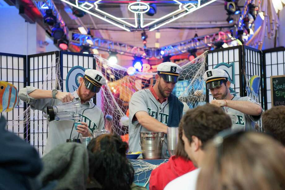Charlie Furbush, Tom Wilhelmsen, Lucas Luetge, and Brandon Maurer of the Seattle Mariners meet fans and make lemonade drinks while filming a sketch. Photo: Thomas Levinson, MLB Photos Via Getty Images / 2013 Major League Baseball Photos