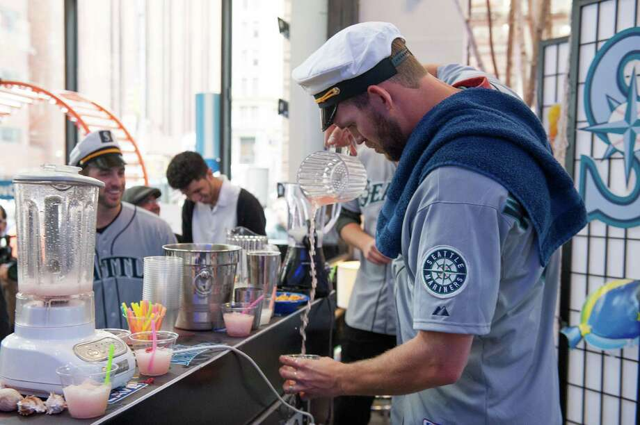 Tom Wilhelmsen of the Seattle Mariners mixes a lemonade drink. Photo: Thomas Levinson, MLB Photos Via Getty Images / 2013 Major League Baseball Photos