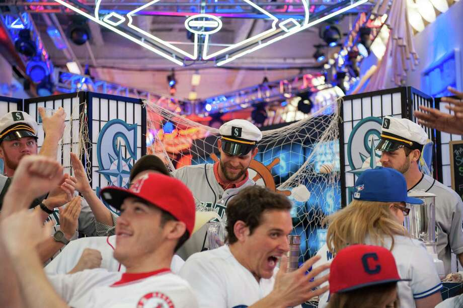The MLB Fan Cave Dwellers get the party started with Charlie Furbush, Tom Wilhelmsen, Lucas Luetge, and Brandon Maurer of the Seattle Mariners while filming a sketch. Photo: Thomas Levinson, MLB Photos Via Getty Images / 2013 Major League Baseball Photos