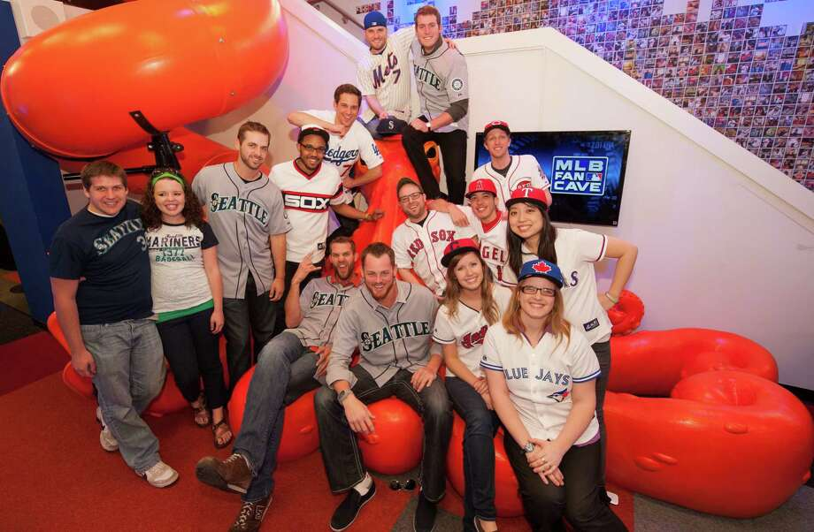 Charlie Furbush, Tom Wilhelmsen, Lucas Luetge, and Brandon Maurer of the Seattle Mariners pose with Cave Crasher Brian Jackson and his wife, Kimberly, and the MLB Fan Cave Dwellers on the Nonopus. Photo: Thomas Levinson, MLB Photos Via Getty Images / 2013 Major League Baseball Photos