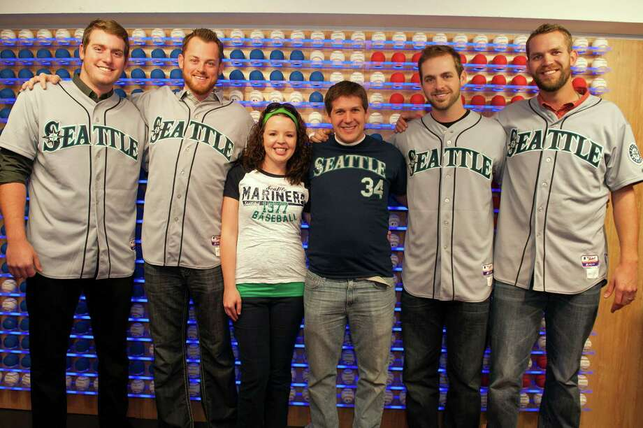 Brandon Maurer, Charlie Furbush, Lucas Luetge, and Tom Wilhelmsen of the Seattle Mariners pose Seattle Mariners Cave Crasher Brian Jackson and his wife, Kimberly, in front of the Rawlings Ball Wall. Photo: Thomas Levinson, MLB Photos Via Getty Images / 2013 Major League Baseball Photos