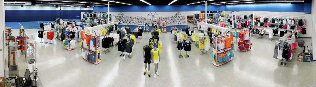 A panoramic view of the new Tennis Express store, 10770 Westheimer, shows the tennis court where customers can try out racquets as well as product displays. The Houston-based retailer has grown tremendously since it opened in 2000.