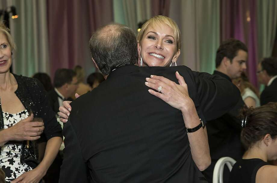 Angelique Griepp gives John Goldman a hug while attending the San Francisco Symphony's inaugural Spring Gala at City Hall in San Francisco, Calif., on Thursday, May 16, 2013. Photo: Laura Morton, Special To The Chronicle