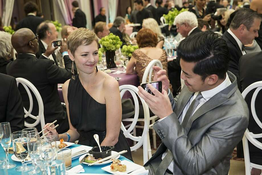 RC Rivera snaps Heather Kelly's photo while attending the San Francisco Symphony's inaugural Spring Gala at City Hall in San Francisco, Calif., on Thursday, May 16, 2013. Photo: Laura Morton, Special To The Chronicle