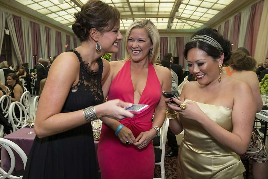 Tiffaney Weisser, Liz Curtis and Ye-Hui Lu debate which photos to post on Instagram while attending the San Francisco Symphony's inaugural Spring Gala at City Hall in San Francisco, Calif., on Thursday, May 16, 2013. Photo: Laura Morton, Special To The Chronicle
