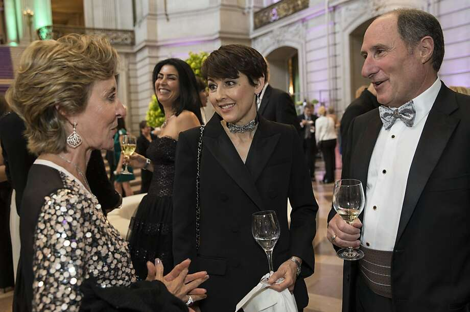 San Francisco Symphony President Sako Fisher (center) talks with Marcia Goldman and former president John Goldman during the San Francisco Symphony's inaugural Spring Gala at City Hall in San Francisco, Calif., on Thursday, May 16, 2013. Photo: Laura Morton, Special To The Chronicle