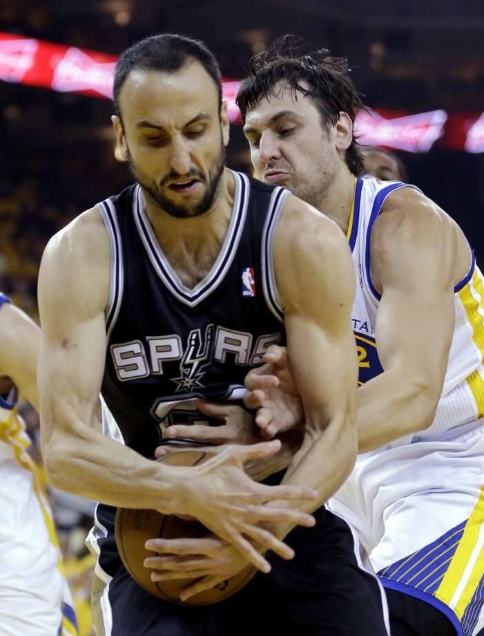 San Antonio Spurs guard Manu Ginobili (20) and Golden State Warriors center Andrew Bogut (12) battle for the ball in the first quarter of Game 6 of a Western Conference semifinal NBA basketball playoff series in Oakland, Calif., Thursday, May 16, 2013. (AP Photo/Marcio Jose Sanchez)