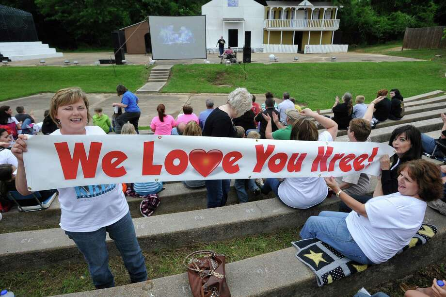 Lynda Walling, left, with help from Suzanne Rigby, right, and others, unrolls a long Kree banner. The City of Woodville hosted a Kree Harrison watch party Thursday night at the Joe Wheat Dogwood Amphitheater in downtown Woodville. Upwards of 150 people sat on concrete, chairs, and blankets to enjoy the two hour season finale of American Idol  Dave Ryan/The Enterprise Photo: Dave Ryan