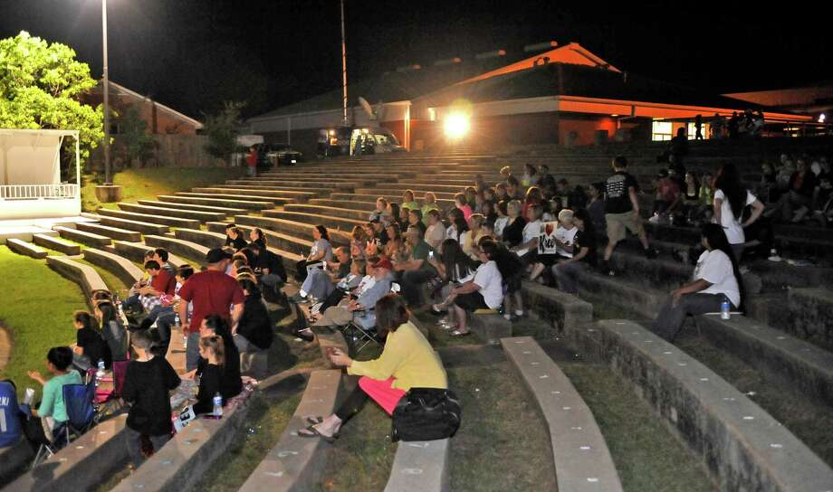 The crowd awaits the announcement of the winner. The City of Woodville hosted a Kree Harrison watch party Thursday night at the Joe Wheat Dogwood Amphitheater in downtown Woodville. Upwards of 150 people sat on concrete, chairs, and blankets to enjoy the two hour season finale of American Idol  Kree Harrison came in second place.  Dave Ryan/The Enterprise Photo: Dave Ryan