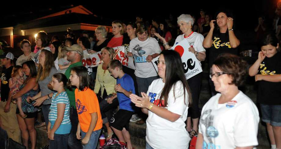 The upper row of Lynda Walling, left, Ruthie Rogers, and Lisa Ogden, right, along with everyone else, react to the announcement that Kree Harrison had lost to Candice Glover.  The City of Woodville hosted a Kree Harrison watch party Thursday night at the Joe Wheat Dogwood Amphitheater in downtown Woodville. Upwards of 150 people sat on concrete, chairs, and blankets to enjoy the two hour season finale of American Idol  Kree Harrison came in second place.  Dave Ryan/The Enterprise Photo: Dave Ryan