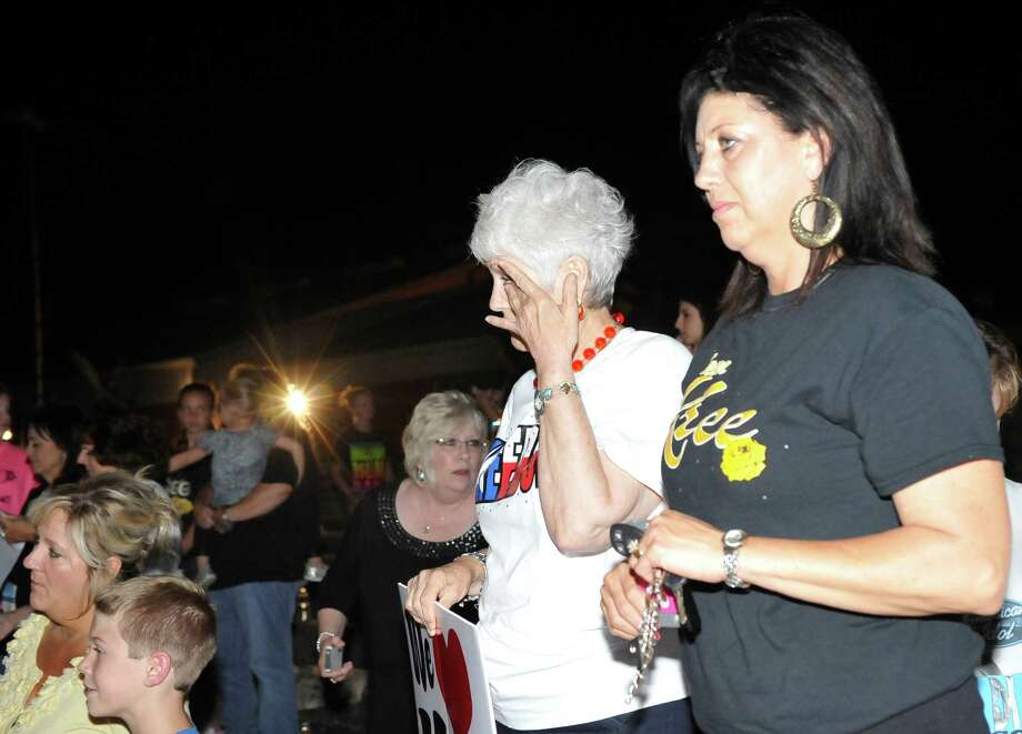 Ruthie Rogers, and Lisa Ogden, right, along with everyone else, react to the announcement that Kree Harrison had lost to Candice Glover.  The City of Woodville hosted a Kree Harrison watch party Thursday night at the Joe Wheat Dogwood Amphitheater in downtown Woodville. Upwards of 150 people sat on concrete, chairs, and blankets to enjoy the two hour season finale of American Idol  Kree Harrison came in second place.  Dave Ryan/The Enterprise