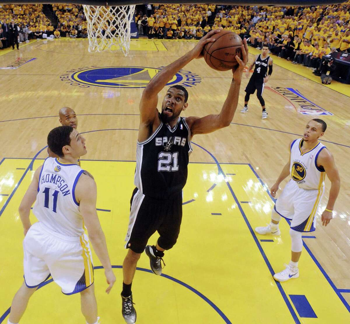 The Spurs' Tim Duncan, getting free for a shot inside between Golden State's Klay Thompson (from left), Jarrett Jack and Stephen Curry, scored 19 points to go with six boards and three blocks in Thursday's win.