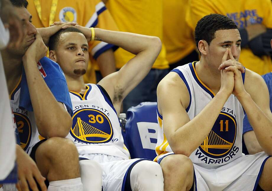 L-R, Andrew Bogut, Stephen Curry, and Klay Thompson sit on the bench as the game was winding down with the Warriors losing to the Spurs 94-82. The Golden State Warriors played the San Antonio Spurs in Game 6 of the Western Conference Semifinals at Oracle Arena in Oakland, Calif., on Thursday, May 16, 2013. Photo: Carlos Avila Gonzalez, The Chronicle