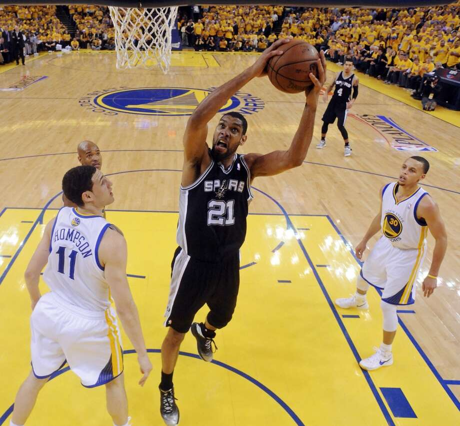 San Antonio Spurs' Tim Duncan shoots between Golden State Warriors' Klay Thompson Golden State Warriors' Jarrett Jack and Golden State Warriors' Stephen Curry during first half action of Game 6 in the NBA Western Conference semifinals Thursday May 16, 2013 at Oracle Arena in Oakland, CA.