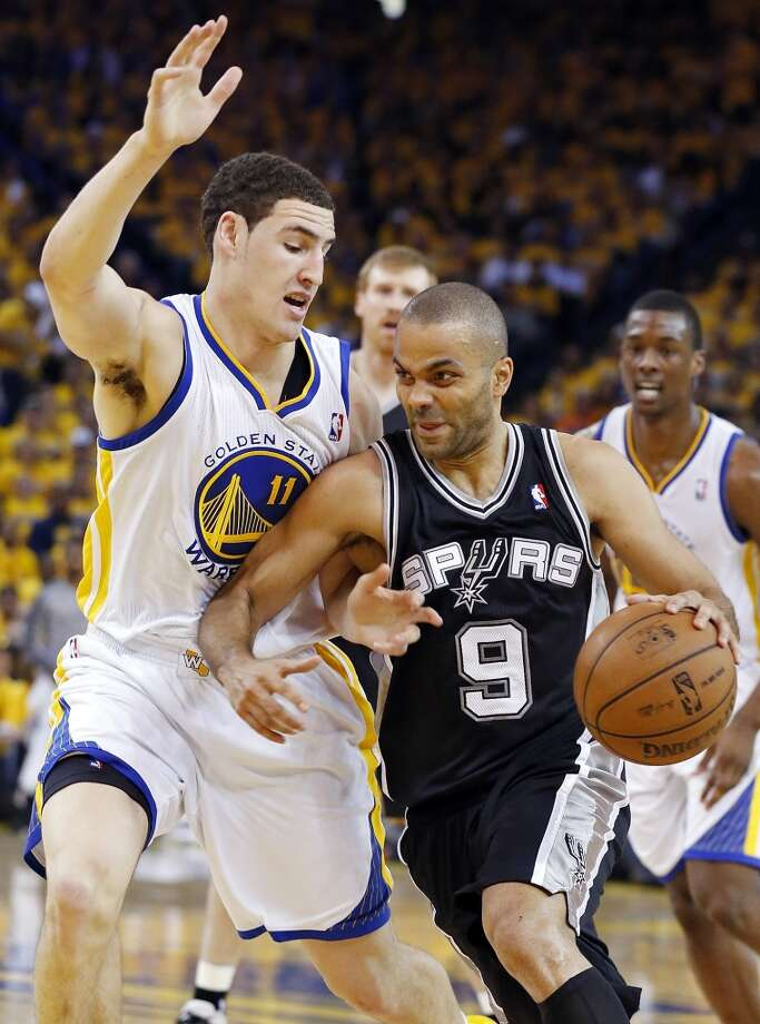San Antonio Spurs' Tony Parker looks for room around Golden State Warriors' Klay Thompson during first half action of Game 6 in the NBA Western Conference semifinals Thursday May 16, 2013 at Oracle Arena in Oakland, CA.