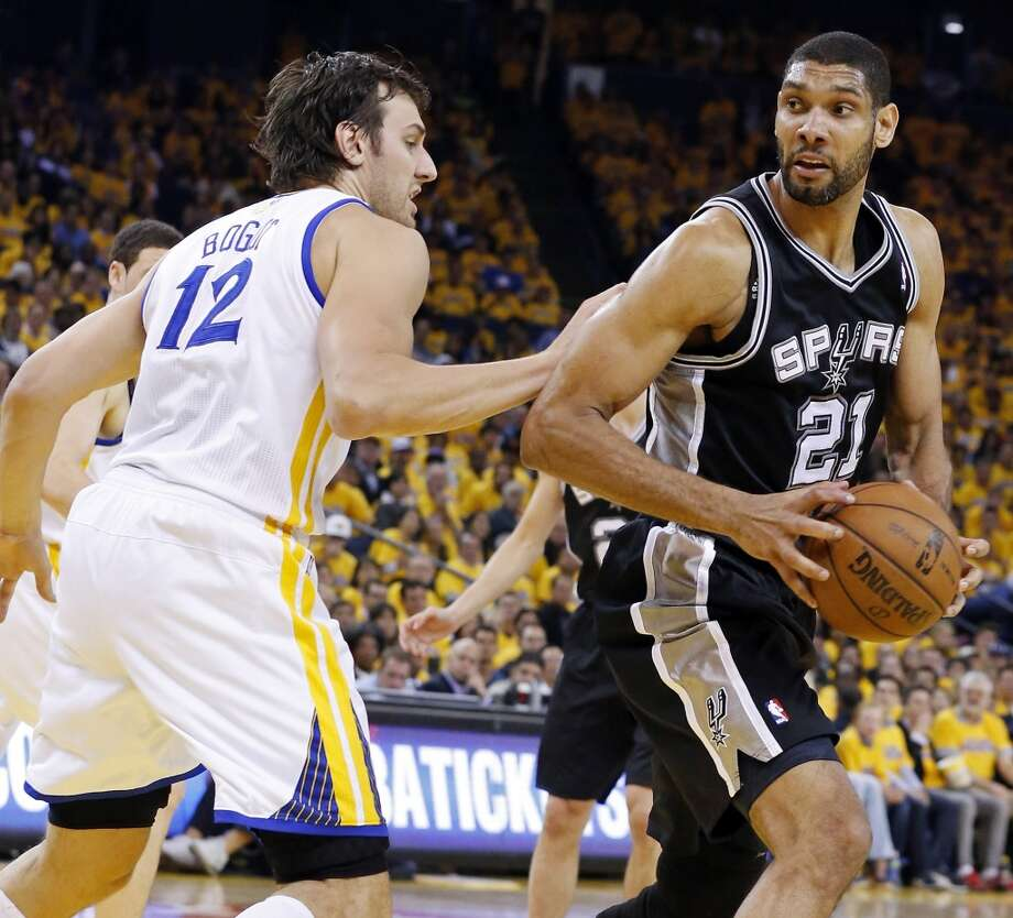 San Antonio Spurs' Tim Duncan looks for room around Golden State Warriors' Andrew Bogut during first half action of Game 6 in the NBA Western Conference semifinals Thursday May 16, 2013 at Oracle Arena in Oakland, CA.