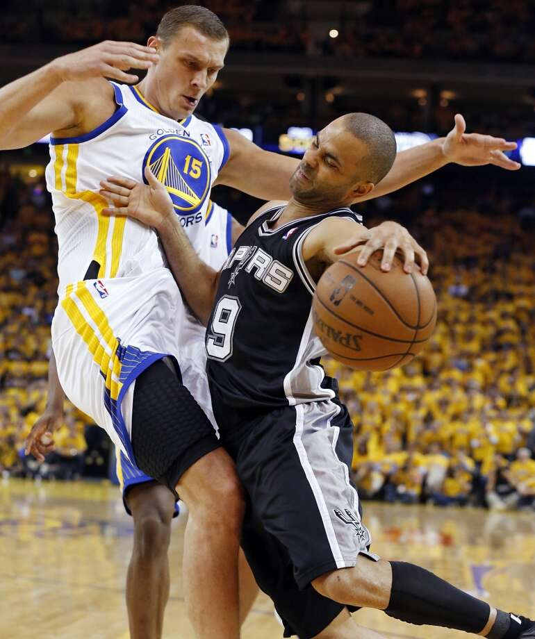 San Antonio Spurs' Tony Parker looks for room around Golden State Warriors' Andris Biedrins during first half action of Game 6 in the NBA Western Conference semifinals Thursday May 16, 2013 at Oracle Arena in Oakland, CA.