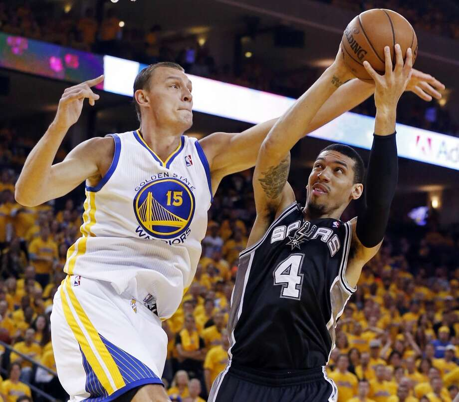 Golden State Warriors' Andris Biedrins and San Antonio Spurs' Danny Green grab for a rebound during first half action of Game 6 in the NBA Western Conference semifinals Thursday May 16, 2013 at Oracle Arena in Oakland, CA.
