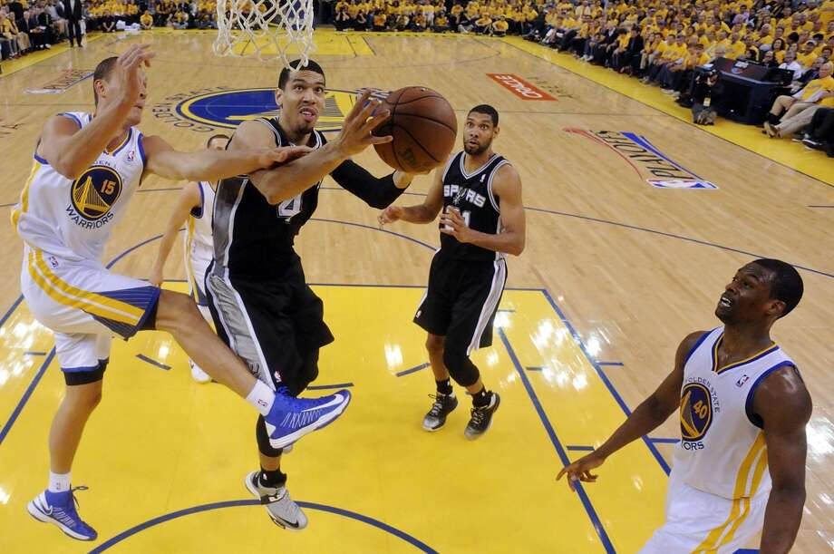 San Antonio Spurs' Danny Green shoots around Golden State Warriors' Andris Biedrins during first half action of Game 6 in the NBA Western Conference semifinals Thursday May 16, 2013 at Oracle Arena in Oakland, CA.