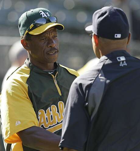 FILE - In this July 19, 2012, file photo Oakland Athletics' Rickey Henderson, left, speaks with New York Yankees special adviser Reggie Jackson before their baseball game in Oakland, Calif. The Hall of Famer sure has been a positive influence in his role as roving instructor for the reigning AL West champions Athletics. (AP Photo/Ben Margot, File) Photo: Ben Margot, Associated Press