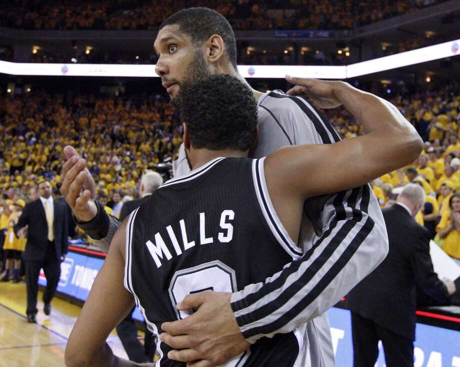 San Antonio Spurs' Tim Duncan and San Antonio Spurs' Patty Mills hug after Game 6 in the NBA Western Conference semifinals against the Golden State Warriors Thursday  May 16, 2013 at Oracle Arena in Oakland, CA. The Spurs won 94-82.