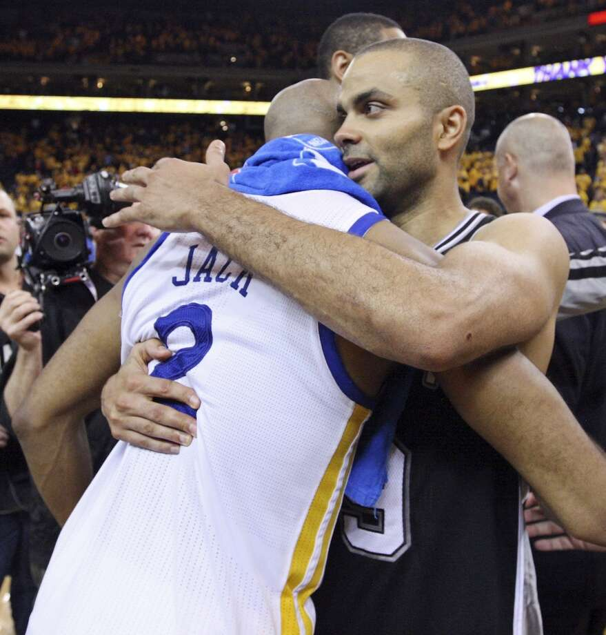 Golden State Warriors' Jarrett Jack and San Antonio Spurs' Tony Parker hug after Game 6 in the NBA Western Conference semifinals Thursday  May 16, 2013 at Oracle Arena in Oakland, CA. The Spurs won 94-82.