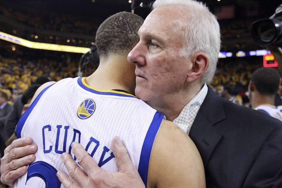 Golden State Warriors' Stephen Curry and San Antonio Spurs head coach Gregg Popovich hug after Game 6 in the NBA Western Conference semifinals Thursday  May 16, 2013 at Oracle Arena in Oakland, CA. The Spurs won 94-82.