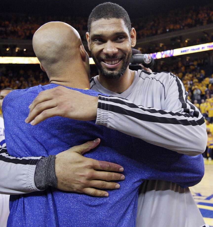 Golden State Warriors' Richard Jefferson and San Antonio Spurs' Tim Duncan hug after Game 6 in the NBA Western Conference semifinals Thursday  May 16, 2013 at Oracle Arena in Oakland, CA. The Spurs won 94-82.