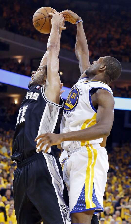 San Antonio Spurs' Tim Duncan and Golden State Warriors' Festus Ezeli grab for a rebound during second half action of Game 6 in the NBA Western Conference semifinals Thursday  May 16, 2013 at Oracle Arena in Oakland, CA. The Spurs won 94-82.