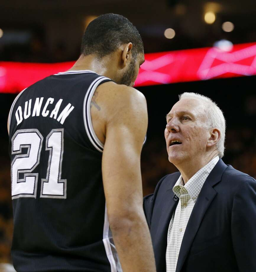 San Antonio Spurs' Tim Duncan talks with San Antonio Spurs head coach Gregg Popovich during second half action of Game 6 in the NBA Western Conference semifinals against the Golden State Warriors Thursday  May 16, 2013 at Oracle Arena in Oakland, CA. The Spurs won 94-82.