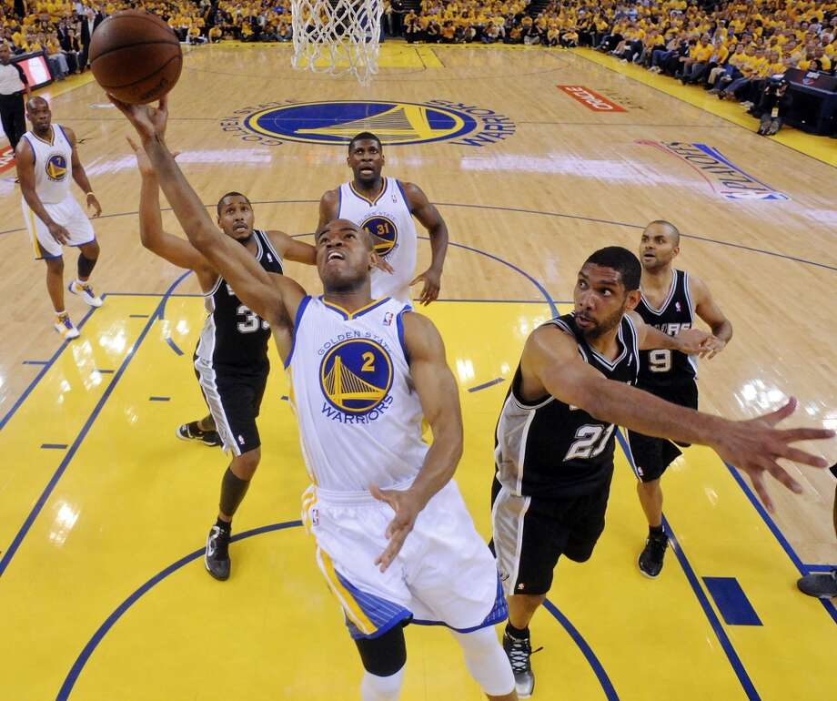 Golden State Warriors' Jarrett Jack shoots between San Antonio Spurs' Boris Diaw and San Antonio Spurs' Tim Duncan during second half action of Game 6 in the NBA Western Conference semifinals Thursday  May 16, 2013 at Oracle Arena in Oakland, CA. The Spurs won 94-82.