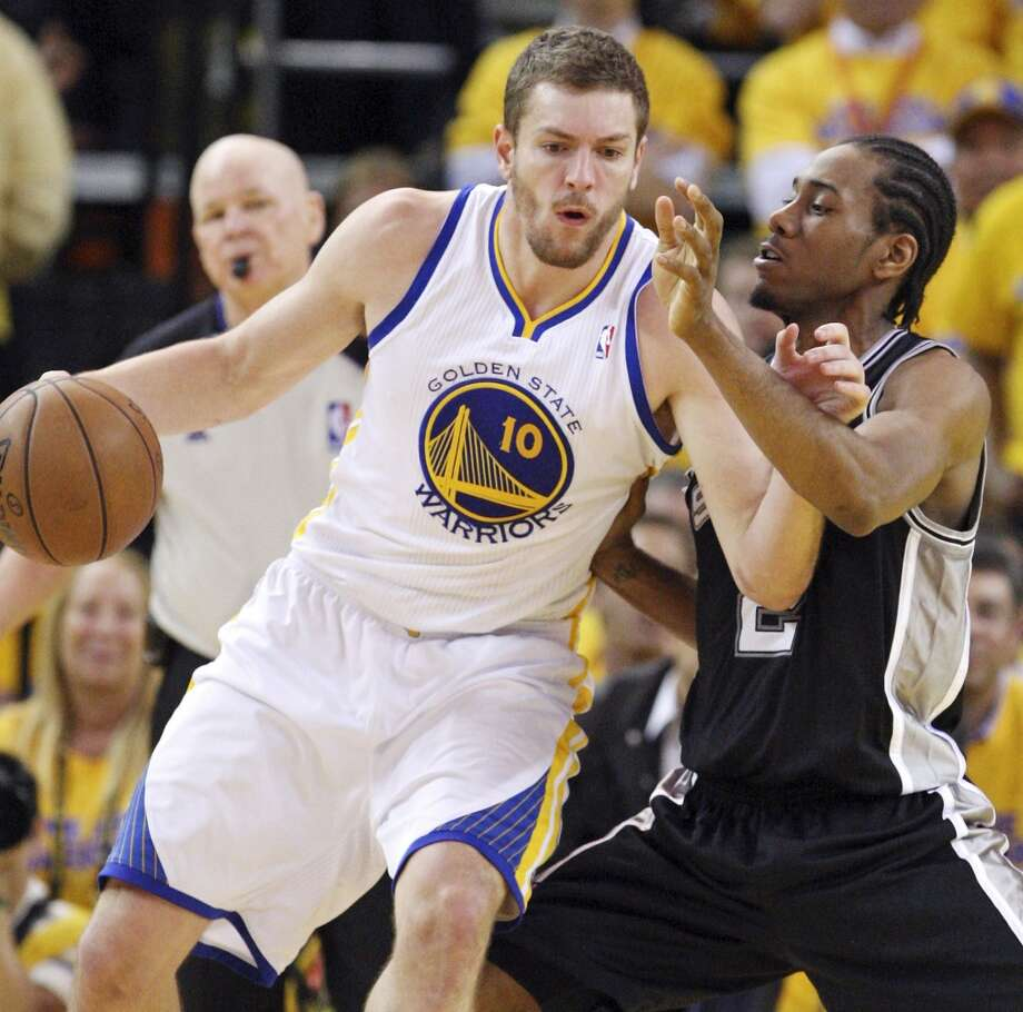 Golden State Warriors' David Lee looks for room around San Antonio Spurs' Kawhi Leonard during second half action of Game 6 in the NBA Western Conference semifinals Thursday  May 16, 2013 at Oracle Arena in Oakland, CA. The Spurs won 94-82.
