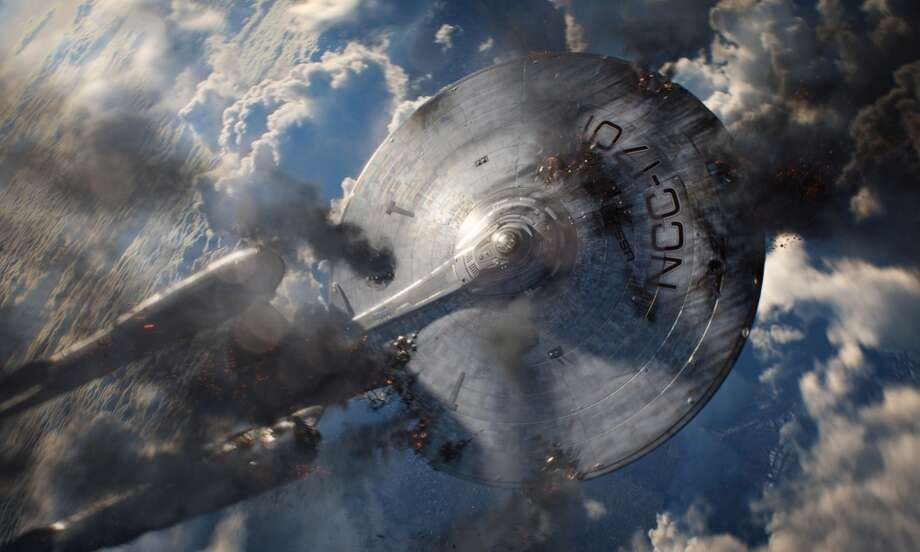 "This film publicity image released by Paramount Pictures shows the starship Enterprise in a scene from ""Star Trek Into Darkness."" (AP Photo/Paramount Pictures)"