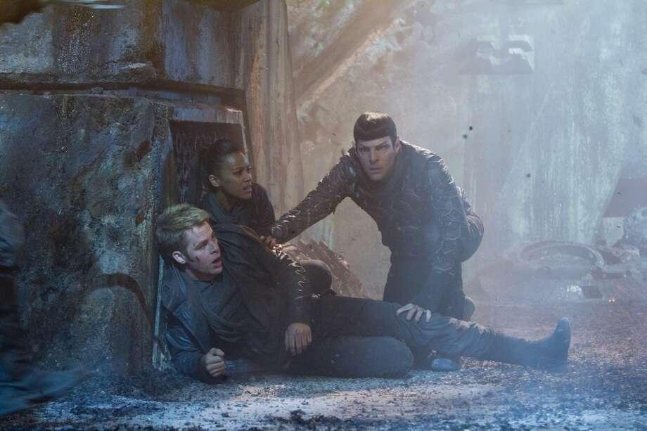 "Chris Pine, Zachary Quinto, and Zoe Saldana star in, ""Star Trek Into Darkness."""