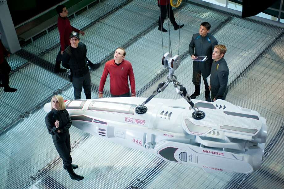 "(Clockwise from front) Alice Eve is Carol, Simon Pegg is Scotty, Karl Urban is Bones and Chris Pine is Kirk in ""Star Trek Into the Darkness."""