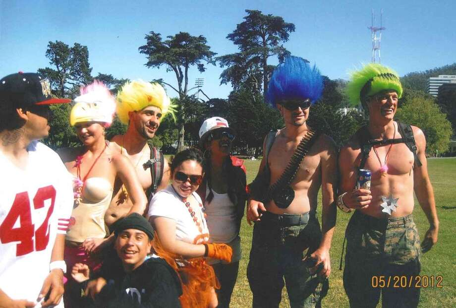 Stephen Martin, at right in the green wig, with friends and members of a group that included a man who later punched Martin, causing him to hit his head on the ground and lose consciousness. Martin never recovered from the post-Bay to Breakers attack May 20, 2012, and died June 8, 2012. Photo: San Francisco Police Department