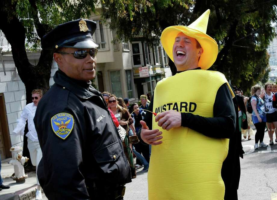Officer Wilson checked out the contents of Mr. Mustard during the Bay to Breakers race in 2011. Photo: Brant Ward, The Chronicle / SFC