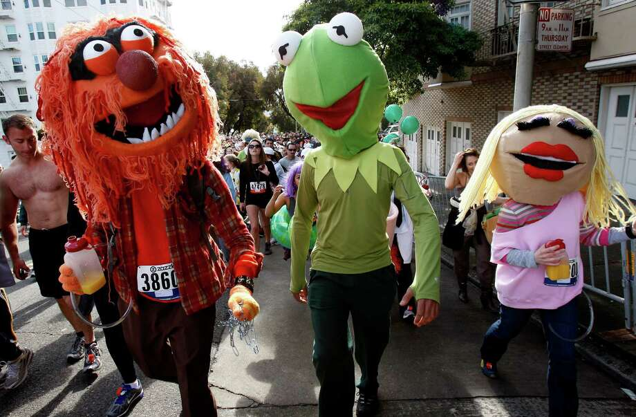 People dressed as Muppet Show characters walk the last part of the steep Hayes Street portion of the Bay to Breakers footrace on Sunday, May 15, 2011, in San Francisco. Photo: Brant Ward, The Chronicle / SFC