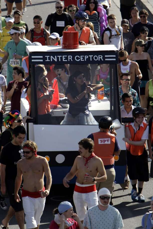 A float makes its way through the crowd during the 98th running of the Bay to Breakers. Photo: Carlos Avila Gonzalez, The Chronicle