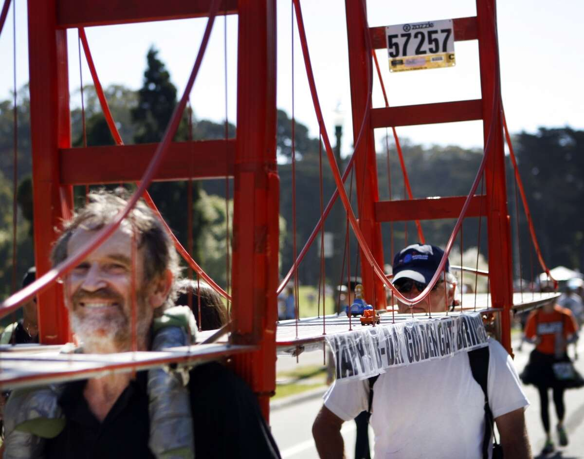 Two men toting a Golden Gate Bridge prop enter Golden Gate Park on Sunday during the 2012 Bay to Breakers.