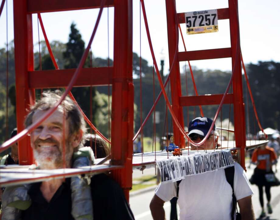 Two men toting a Golden Gate Bridge prop enter Golden Gate Park during the 2012 Bay to Breakers. Photo: Kevin Johnson, The Chronicle