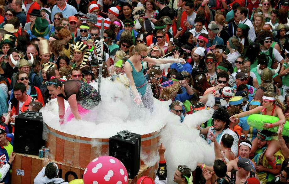 A giant hot tub with lots of suds thrilled the crowd near Alamo Par in 2010. Photo: Brant Ward, The Chronicle / SFC