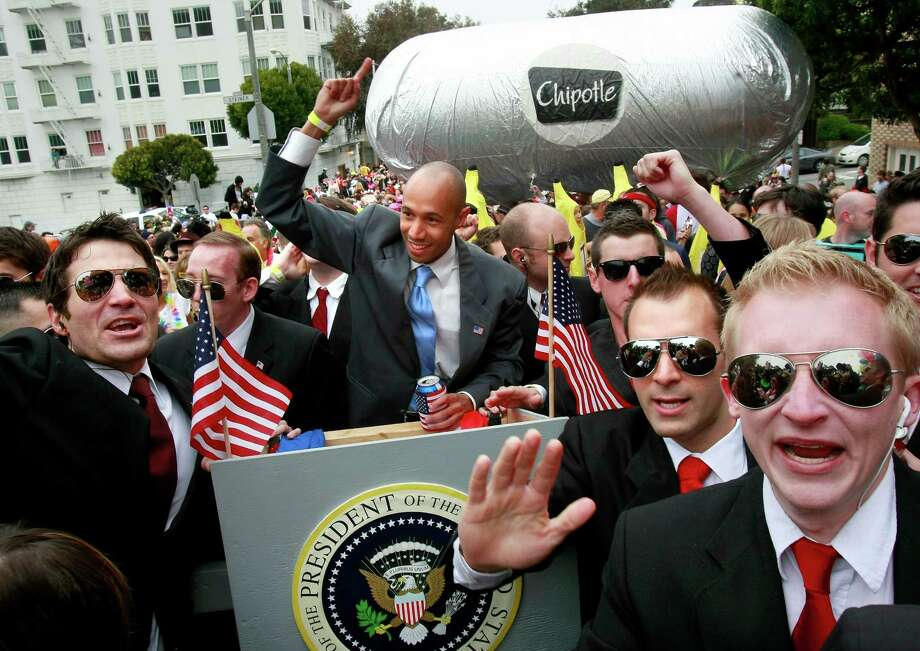 A President Obama look-alike was almost run over by a gigantic food float. Thousands took place in the 99th annual ING Bay to Breakers event on May 16, 2010. Photo: Brant Ward, The Chronicle / SFC