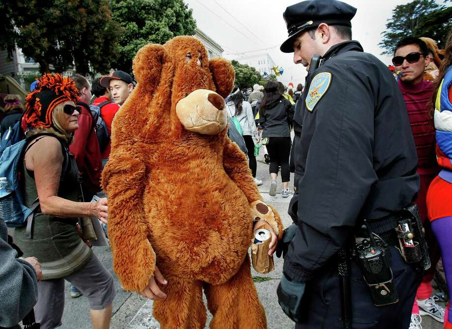Officer Mike Horan confronted a teddy bear with a beer and told him to throw it out during the 100th Bay to Breakers. Photo: Brant Ward, The Chronicle / ONLINE_YES